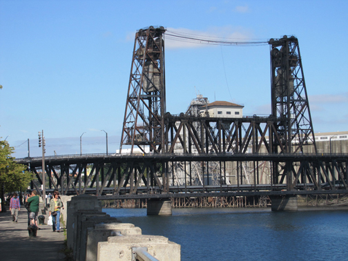 The Steel Bridge is a double-deck vertical-lift bridge across Portland's Willamette River.