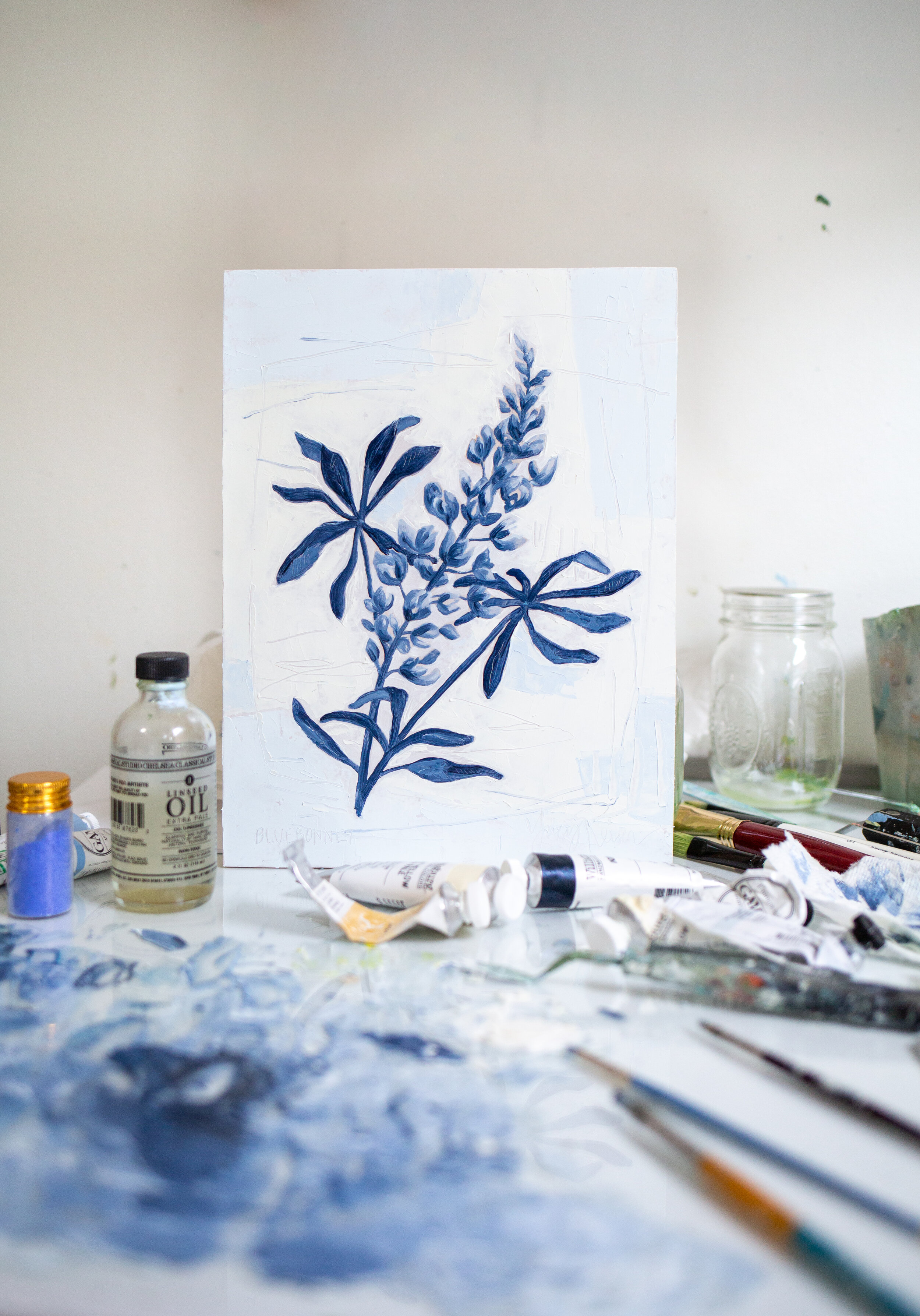 In the studio with oil paints and a Bluebonnet.