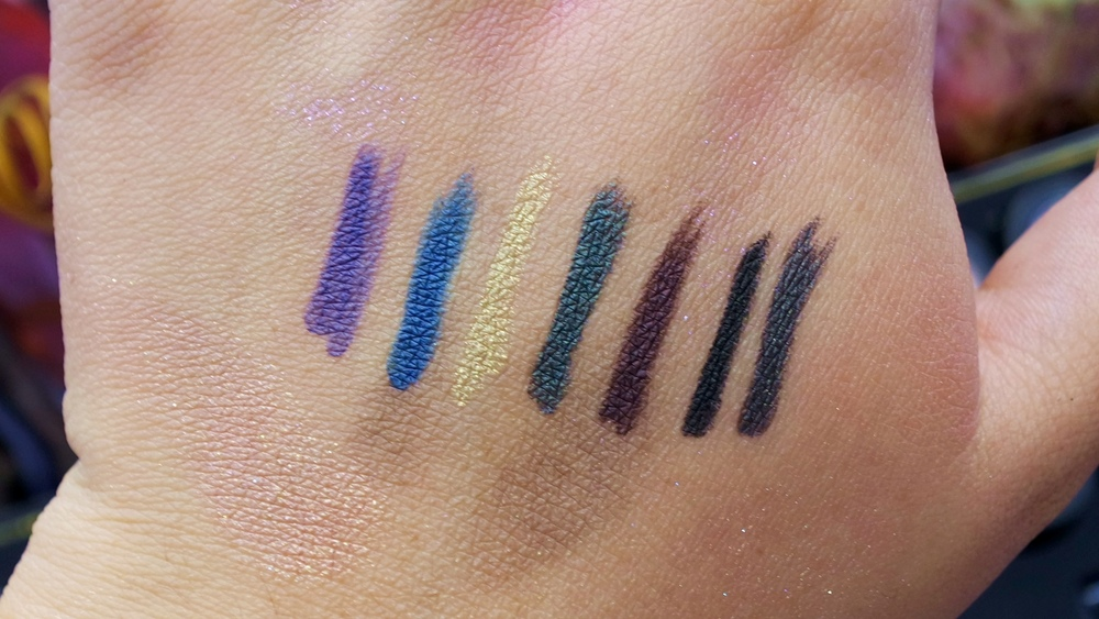 Fluidline Eye Pencil: Evil Twin (blue purple), Deep Blue Sea (deep ocean blue), Atomic Ore (gold), Water Willow (deep khaki green), Earth Sign (deep brown), Black Brilliance (black), Metropolis (deep metal grey)