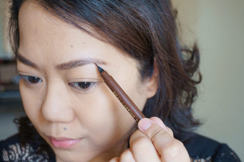 Step 3: Apply your favorite eyebrow makeup. I love using pens since I get more precision without my brows looking overdone. I just draw hair where there are gaps!