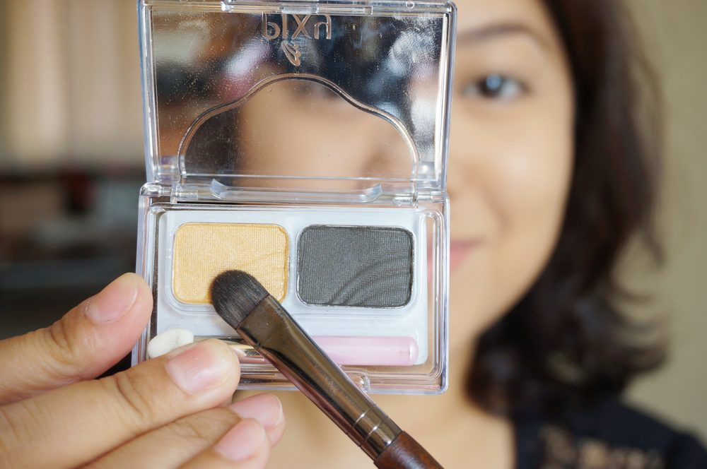 Step 5: With a flat-ish eyeshadow brush, pick up the gold eyeshadow from the Pixy Eyeshadow Palette in Sparkling Gold (P315). Pat it on the lower half of your lids.