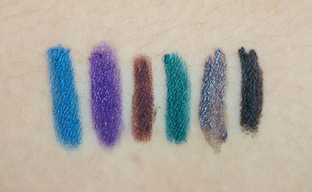 Left to right: Essence Long-Lasting Eye Pencil in Cool Down / Eye of Horus Goddess Pencil in Jewel Amethyst / Pixi pencil in Brown / Prestige Total Intensity Eyeliner in Outrageous Emerald / Make Up For Ever Aqua Liner in #17 / K-Palette black eyeliner