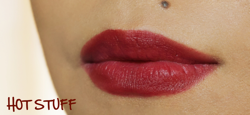 Hot Stuff  is a deep vampy red with a wine-y hue. It is considerably deeper in person than what you see in the swatch above. It's a beautiful, fairly unique color in my collection! It's not something I could wear out often but I do go to a lot of events, in any case.