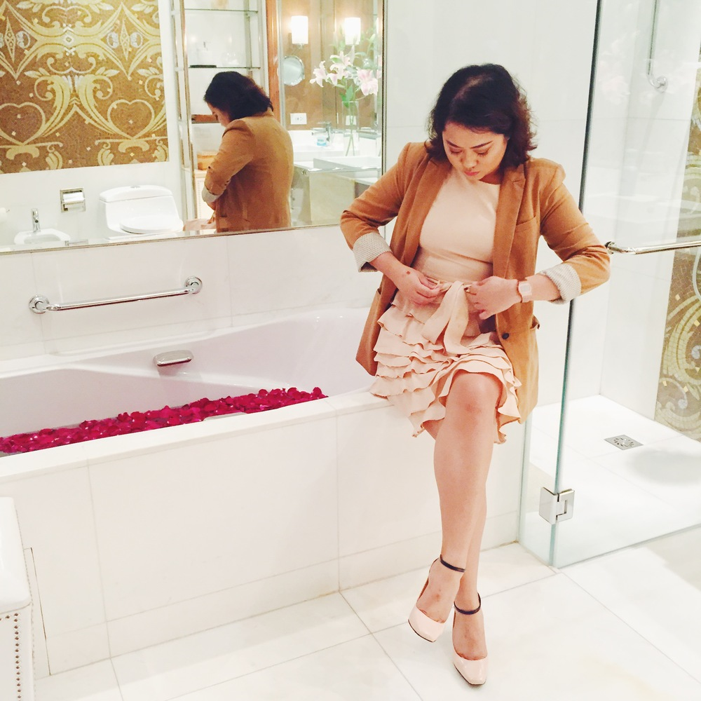 Just sitting in a bath tub full of rose petals, fixing my belt. You know.