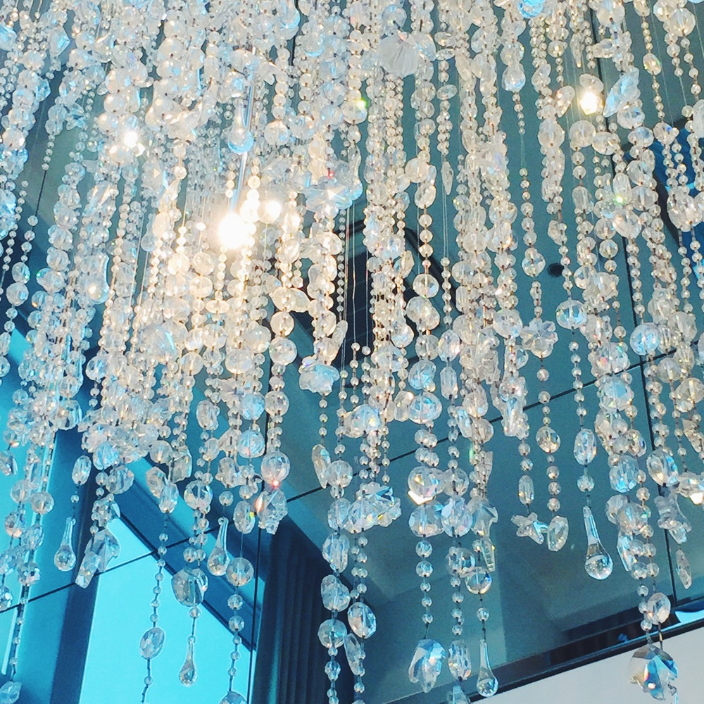 A glittering grand chandelier at the penthouse