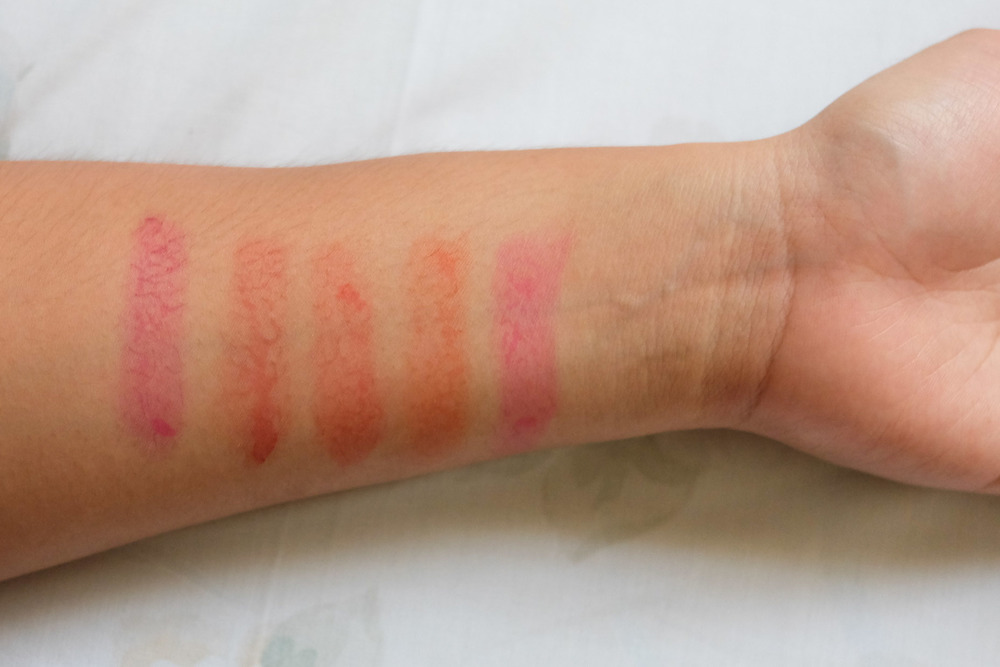 Swatches on my morena skin: Fused, Bittersweet Magenta, Bloodshot, Summer Kiss, and Dolled