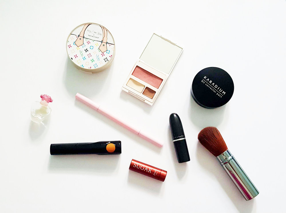 I usually bring a BB cushion like The Face Shop My Other Bag and set it with an oil control powder.