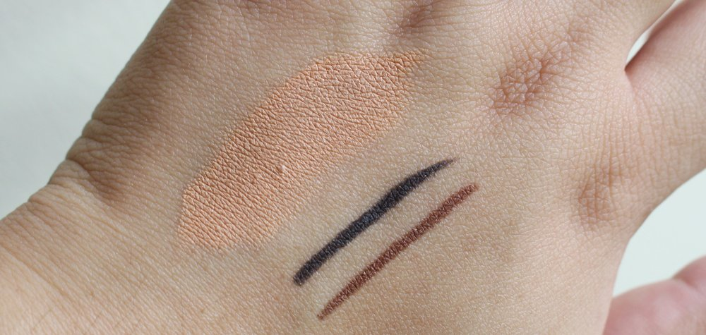A single swipe the Bye Bye, Blues Concealer in Medium, Perfect Black, and Chic Brown