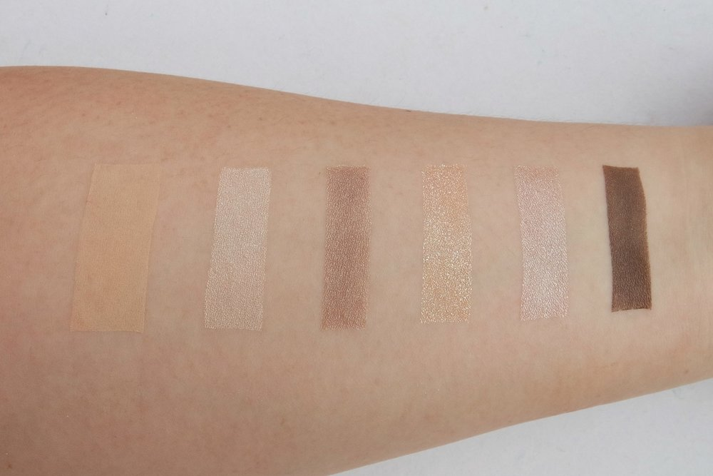 From left: powder foundation, eyeshadows in light, medium, glitter, metallic, and dark