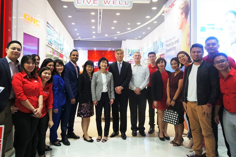US Ambassador to the Philippines Sung Kim joined the GNC team after the SM Aura store's ribbon-cutting