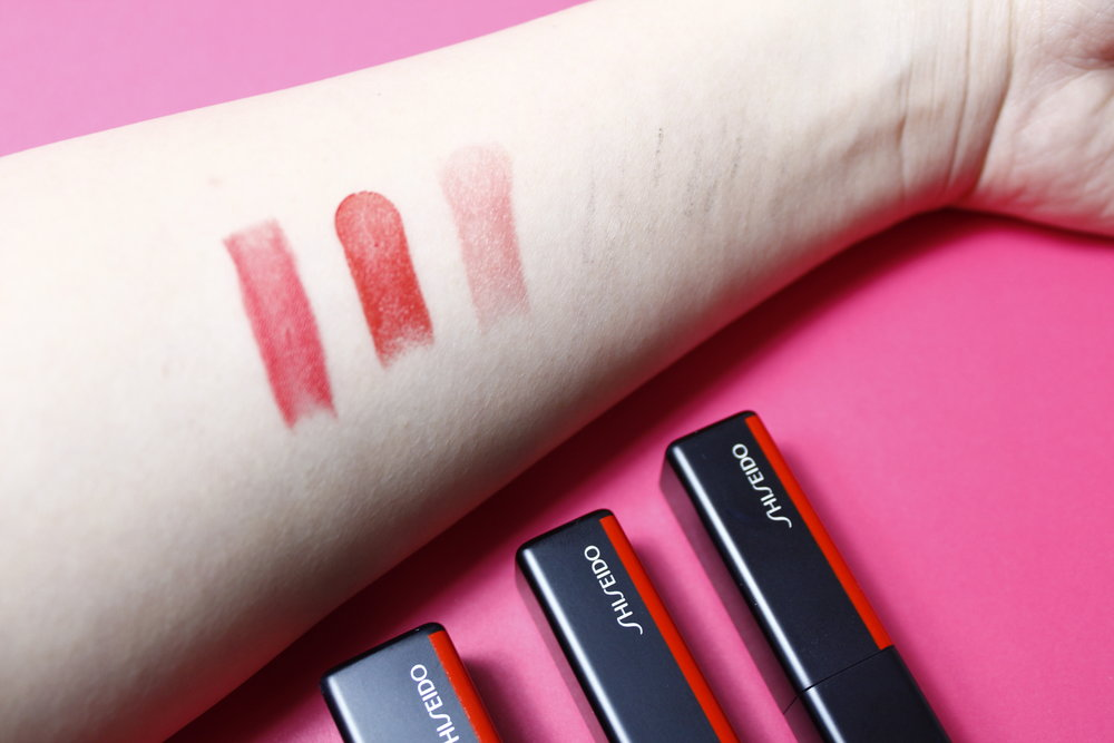 From left: Modern Matte   in  Shock Wave , VisionAiry Gel Lipstick   in  Firecracker , and ColorGel Lip Balm in  Dahlia