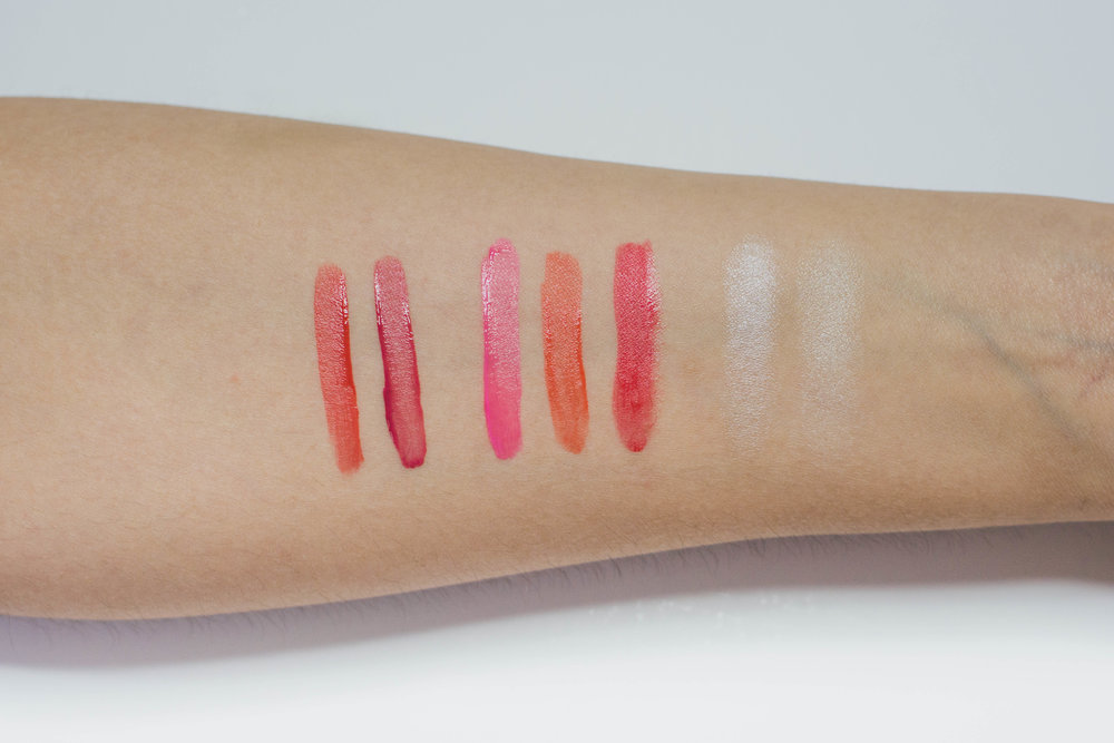 Swatches, from left: Lip Tint Matte in  01 Coral  and  03 Rose , Juicy Lady Liquid Cheek in  01 Rose Pop, 02 Mango Orange,  and  03 Apple Cherry,  Glow Fleur Highlighter in  03 , Cream Highlighter in  03
