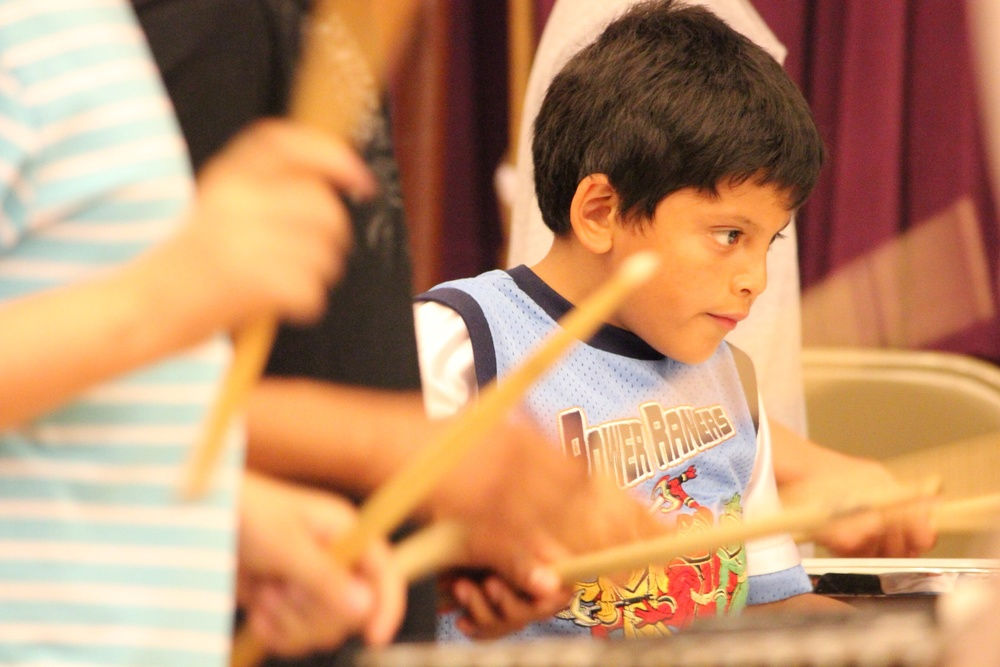 A memeber of the YOURS Project percussion section focused on the music.