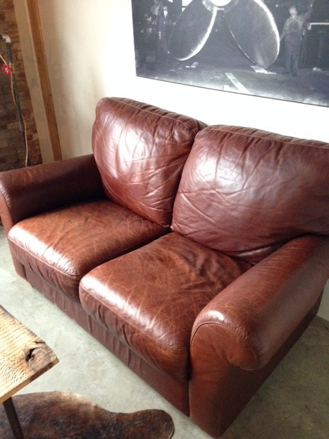 Leather love seat.jpg