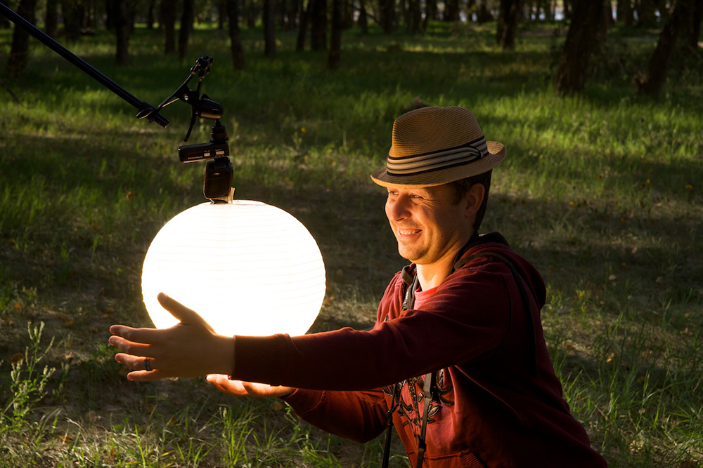 My best attempt at blinding Darren with a paper lantern. This was the technique I used to light Bethany in the butterfly shot. Speed light w/ a full cut CTO.