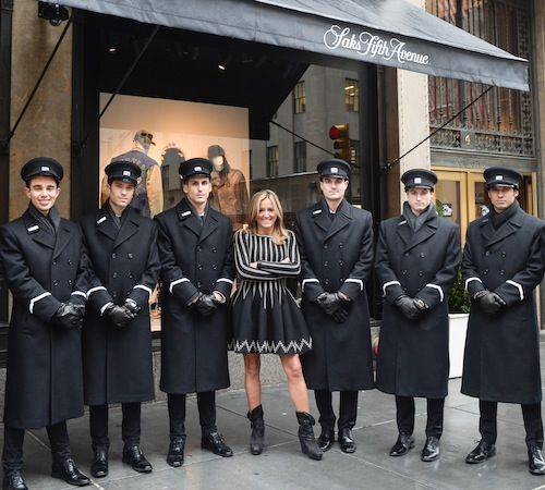 Marigay McKee, President of Saks Fifth Avenue, with her doormen.