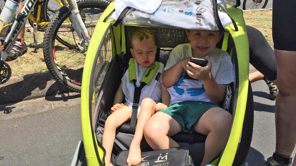 2 kids in chariot.jpg