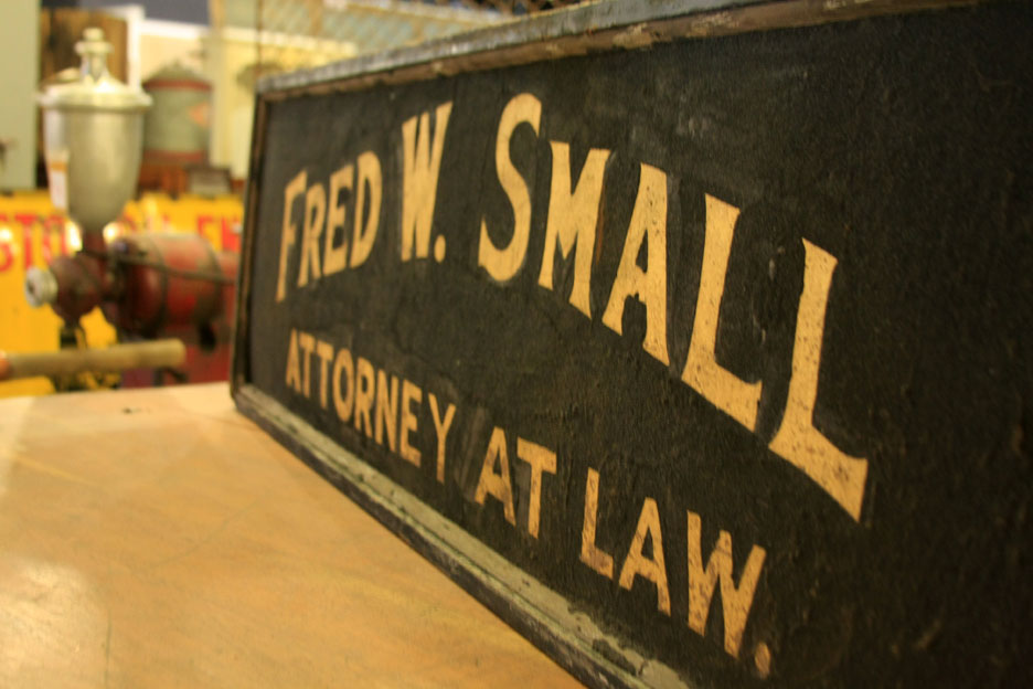 Vintage attorney's sign in Lillian August at Hiden Galleries