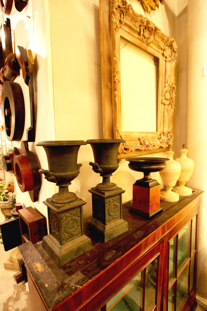 Hiden Galleries: urns and alabaster casottes on 19th-c hanging cabinet