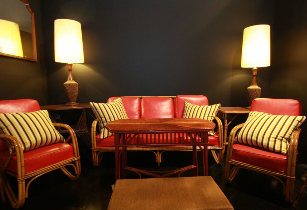 Hiden Galleries: vintage bamboo seating with red cushions