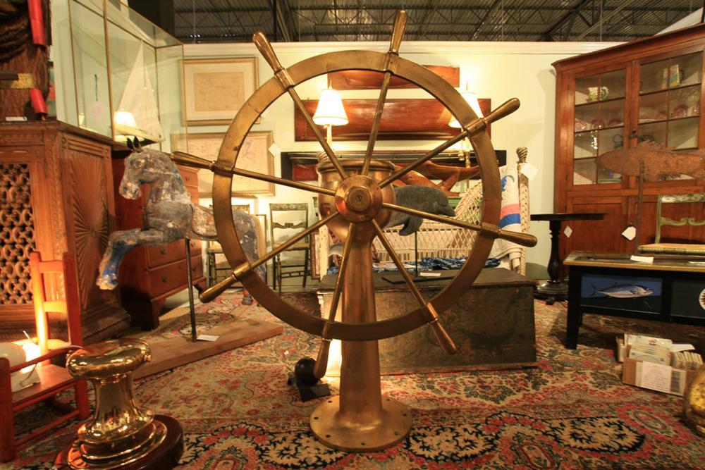 Hiden Galleries: solid brass ship's wheel on pedestal