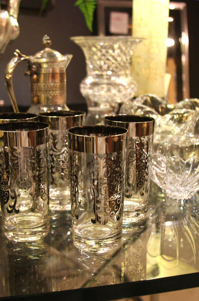 Hiden Galleries: mid-century chrome & glass table with vintage silver-rimmed glasses