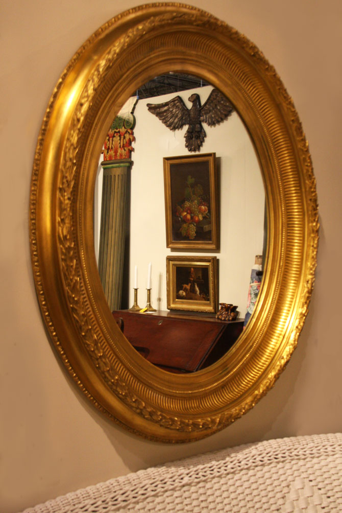 Hiden Galleries: large oval gilded mirror