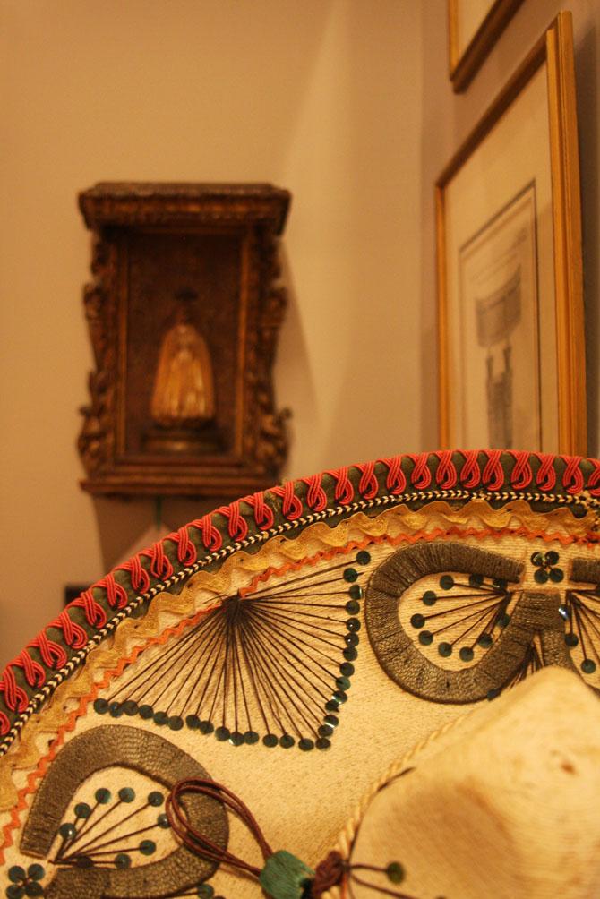 """Hiden Galleries: Mexican sombrero """"La Guadalupana"""", early 18th-century Spanish baroque Santos in background"""