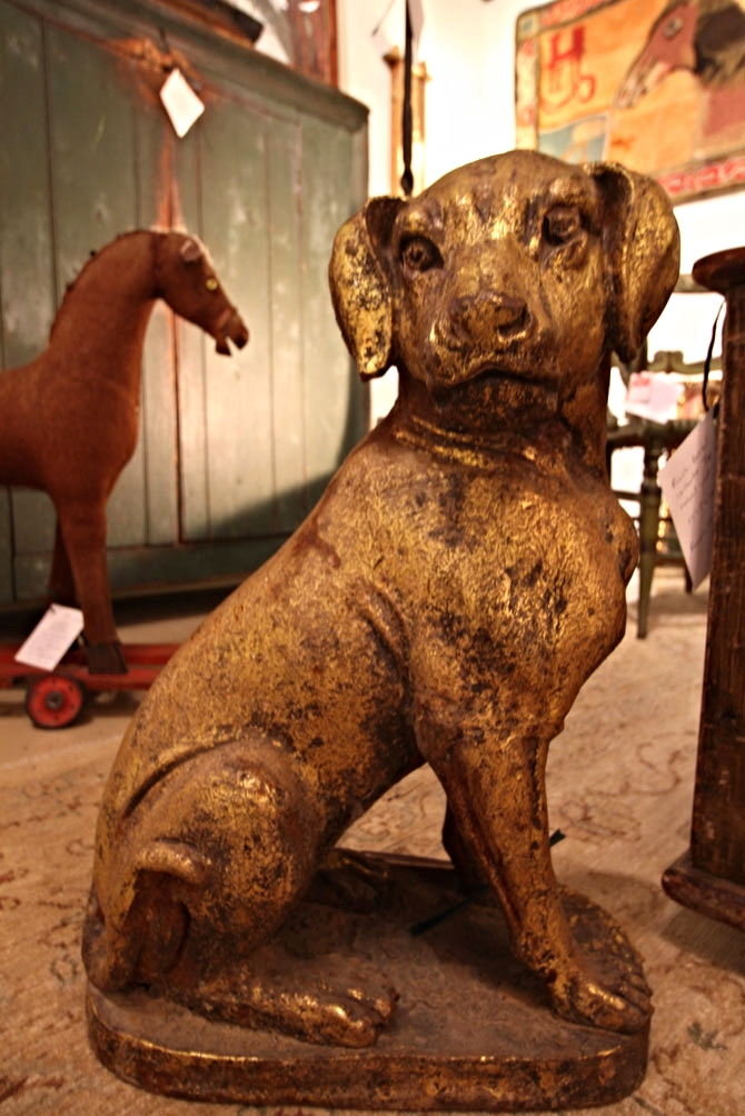19th-century cast iron dog, gilded with leaf