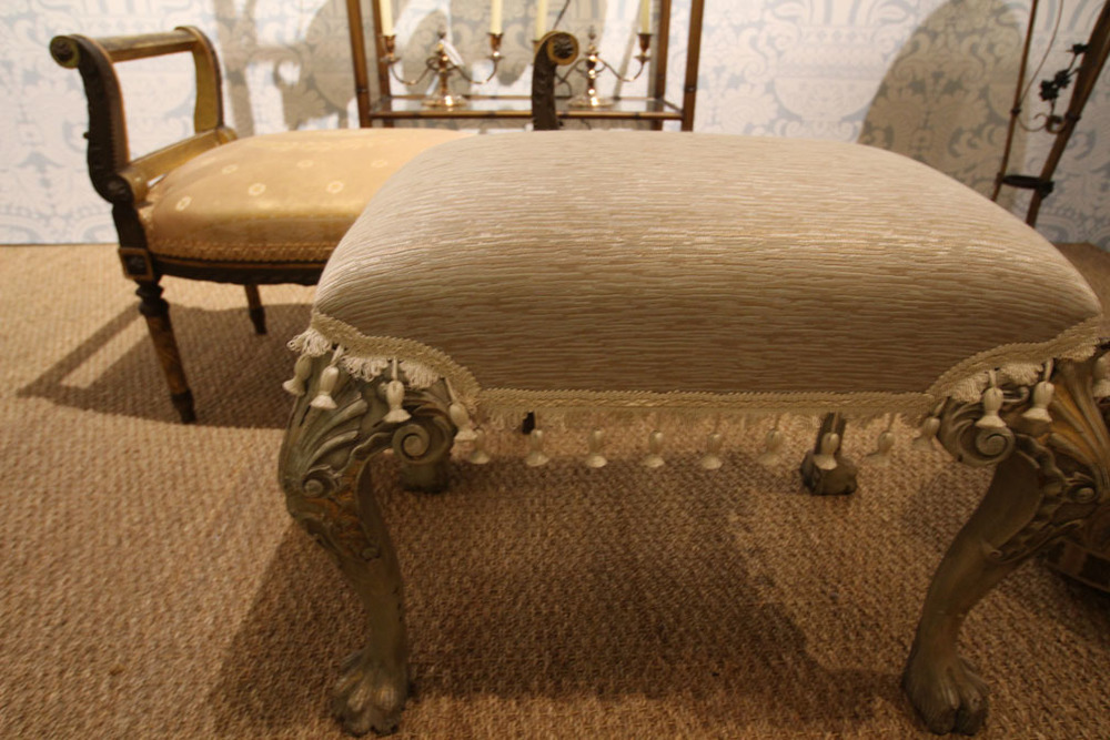 Claw foot painted bench (front); Antique bench in silk damask (rear)