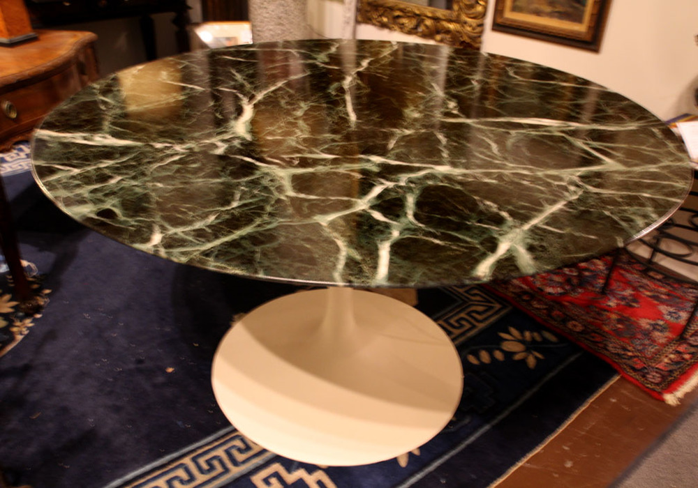 Saarinen marble top dining table by Knoll