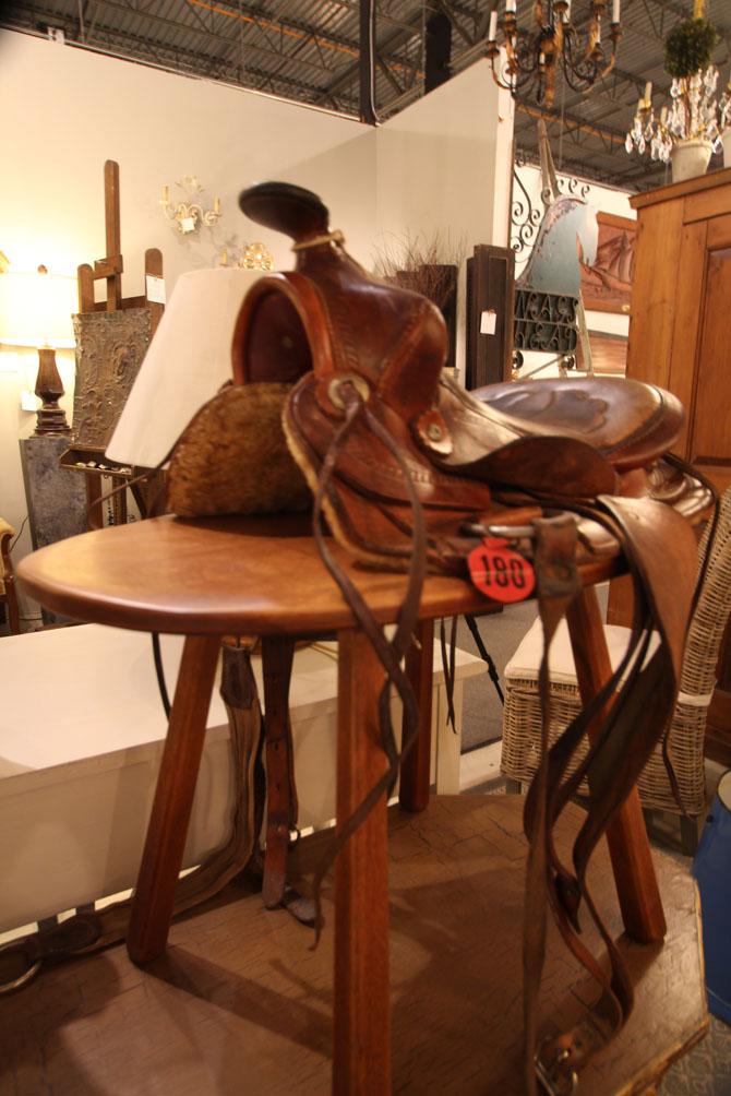 Old Western saddle on pegged pine bench