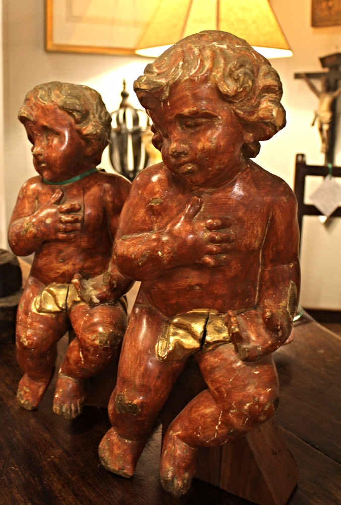 18th-century carved Italian putti, painted and gilded on 17th-century English oak table