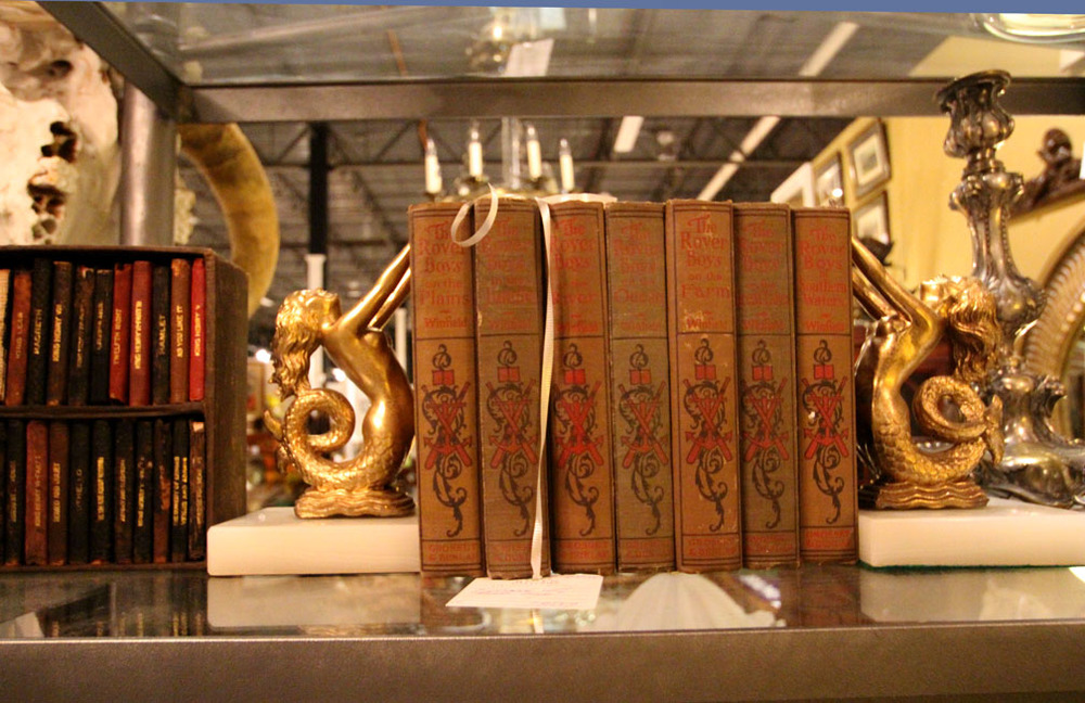 Miniature boxed set of Shakespeare's works (left) and pair of golden mermaid bookends