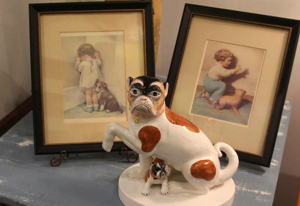 Hiden Galleries: Italian porcelain dog with vintage framed prints of a boy and girl