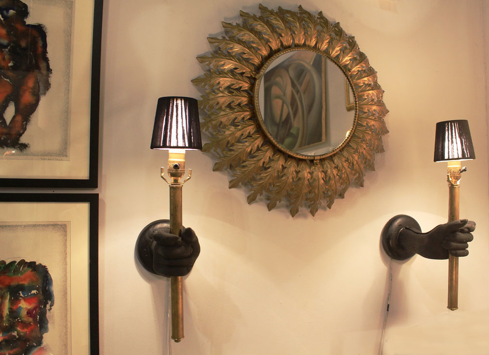 "Hiden Galleries: 1970s mirror flanked by hand-constructed ""hand"" sconces"