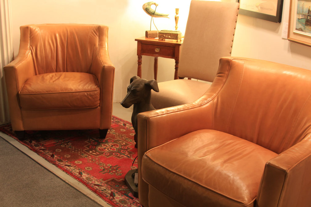 Hiden Galleries: pair of caramel leather club chairs