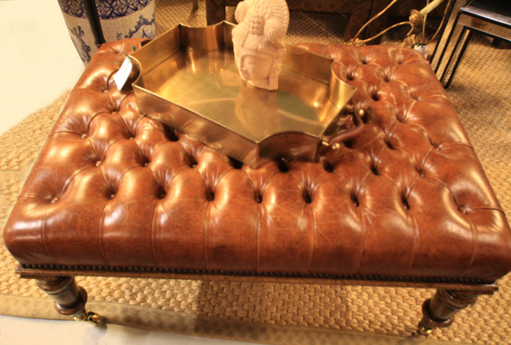 Hiden Galleries: leather tufted ottoman with brass casters