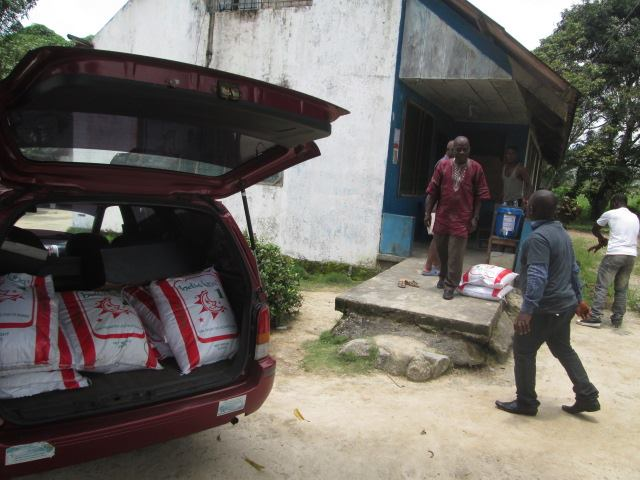 Loading, unloading and delivering rice to needy communities