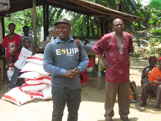 Pastor Philip Davis helping with the distribution of rice