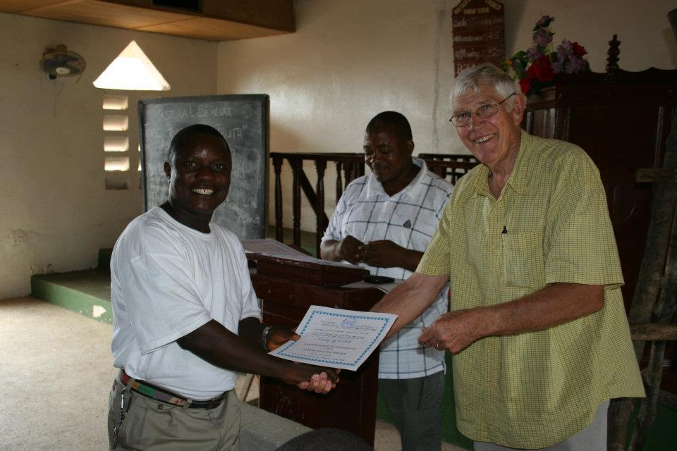 Ken Welch and Philip Davis in 2013. Philip is receiving his completed course certificate.