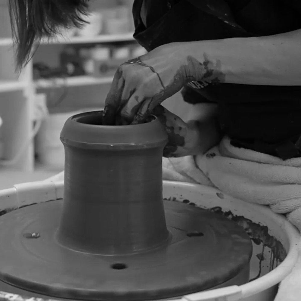 Once the clay is centered on the wheel, the wall of the piece is pulled upward to the desired height, then shaped.