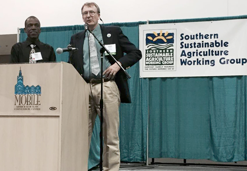 Carlos Robles (left), recently appointed Ag Commissioner for the Virgin Islands, is recognized at the 2015 Practical Tools and Solutions for Sustaining Family Farms conference by Southern SAWG's Executive Director Steve Muntz.