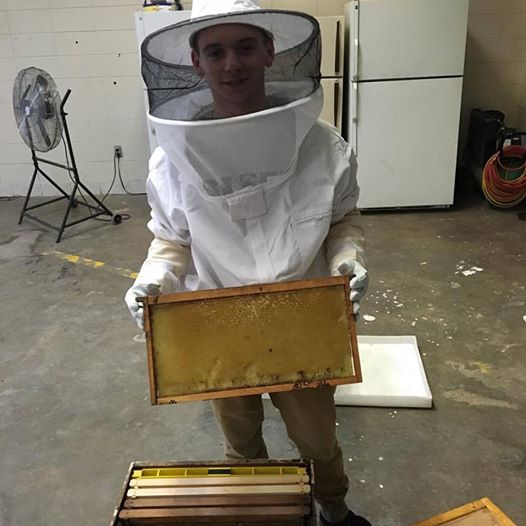 Acadiana High School student shows us how to process honey at their ‎seed change training ‪