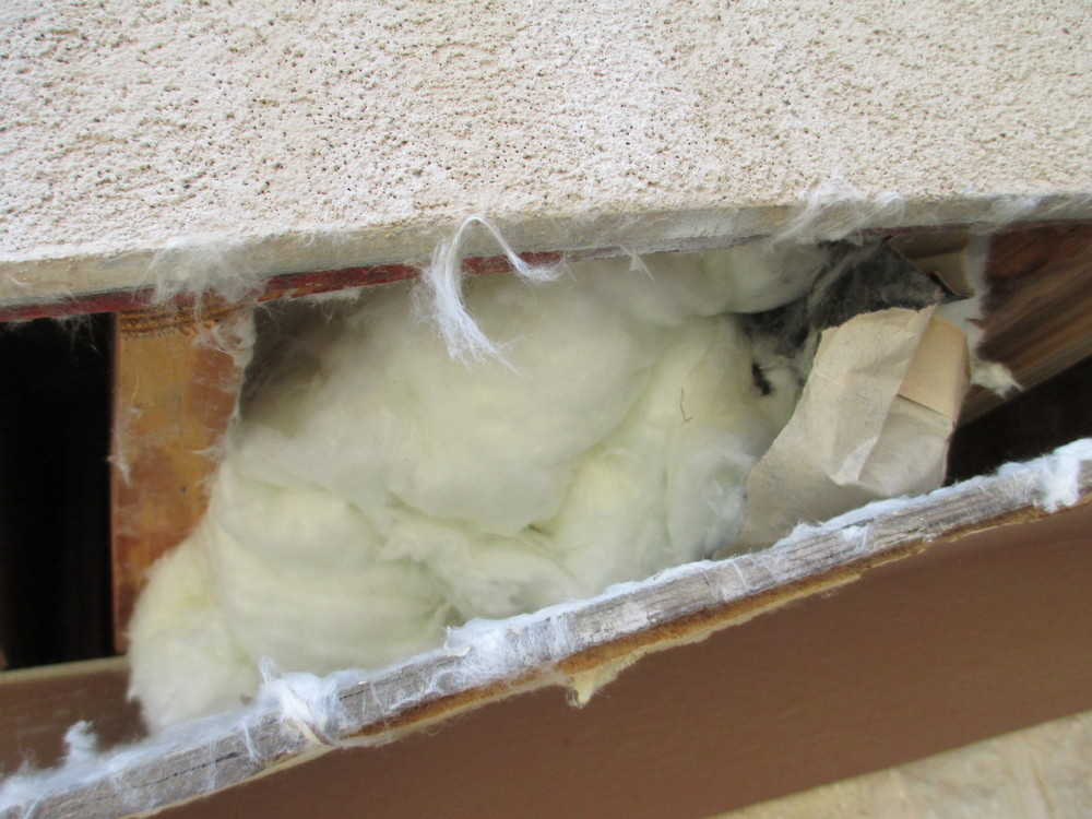Cavity Filled with Fiberglass Insulation