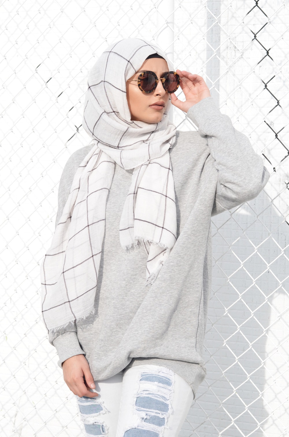 "Cehara Omar in our ""White Gauze Grid"" scarf"