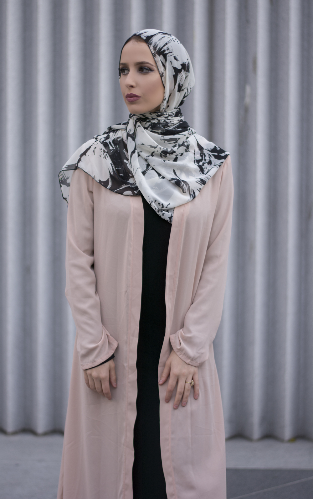 "Emily Aisha in our ""Urban Palms Silk"" scarf"