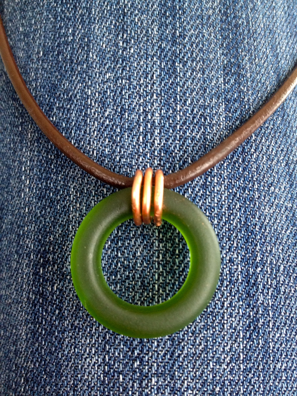 Copy of bottle glass necklace with copper wiring and leather cord.jpg