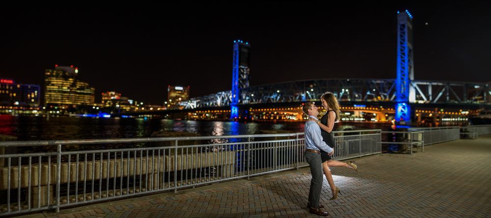 Scott and Megan on the river-walk in downtown Jacksonville with the Main Street Bridge in the background, <3