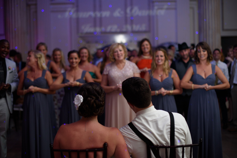 wedding-party-sings-rent-treasury-on-the-plaza-wedding-st-augustine-florida